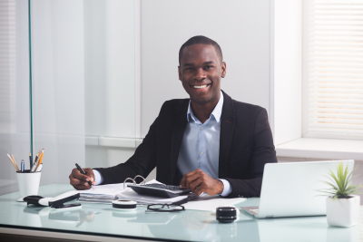 smiling male accountant working at the office